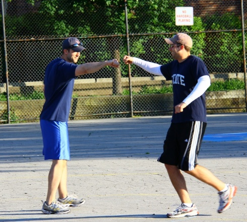 The Lentz brothers bump fists after Mark's solo homer in the bottom of the fourth put Downtown on the board