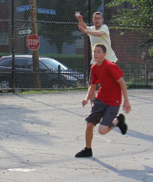 The league's biggest player, Trevar of E&D, attempts to put out the league's smallest player, Kyle, of the Ham Slams