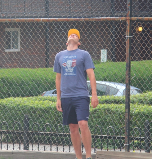 Morrison watches another homer sale over the fence on a windy day with gusts pushing the ball toward Ellsworth Ave.