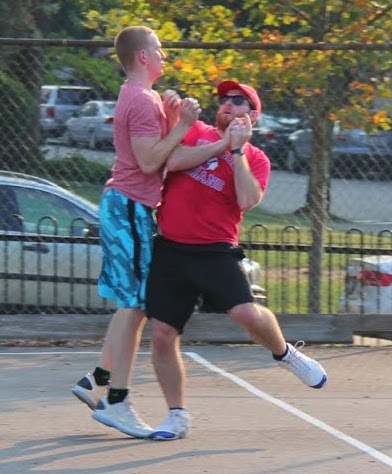 Steve and Tim of the Ham Slams collide as they approach a fly ball