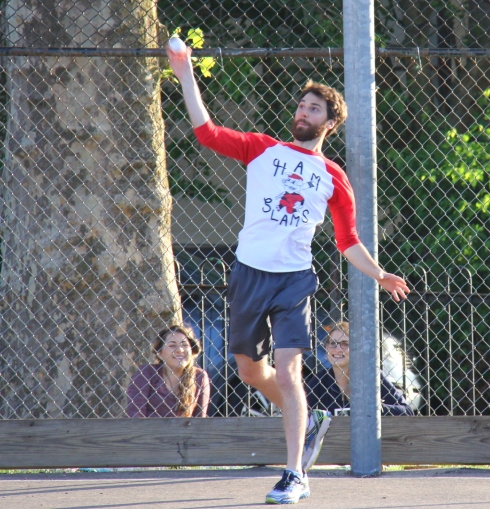 Josh and the Ham Slams defense were chasing balls all night. Here he launches one into the pitcher with a few Ham Slams fans behind him looking on.