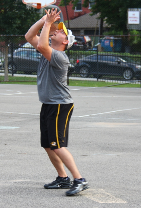 Nate, who pitched the complete game win for Questionable, catches a fly ball at the mound